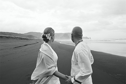 Jon and Marja at their wedding on Piha Beach in New Zealand.